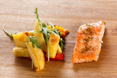 Grilled salmon fillet with vegetables and spices n a plate Royalty Free Stock Photography