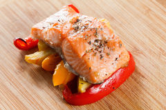 Grilled salmon fillet with vegetables and spices n a plate Stock Image