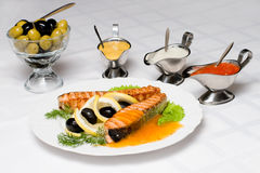 Grilled salmon fish. With fresh, served up with different dressings Stock Photography