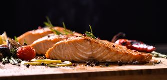 Grilled Salmon Fish And Various Vegetables Royalty Free Stock Photos
