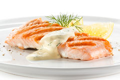 Grilled salmon. Fish dish - roasted salmon on white background royalty free stock photography