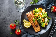 Grilled salmon fillet with vegetables mix. royalty free stock photography