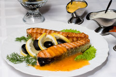 Grilled salmon fish with fresh. Served up with different dressings Stock Images
