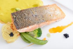 Grilled salmon fish. Salmon fish on a plate serve with some vegetable Stock Image