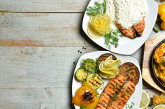 Grilled salmon Fish steak Fillet with BBQ Vegetables and sauce o Stock Photography