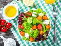 Grilled salmon fish, tomatoes, goat cheese, lettuce, virgin oliv Royalty Free Stock Photography