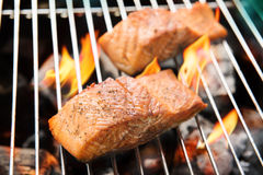 Grilled salmon on the flaming Royalty Free Stock Photography