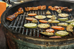 Grilled salmon. On the flaming grill with vegetables stock photography