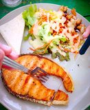 Grilled Salmon with fresh salad Royalty Free Stock Photo