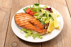 Grilled salmon and salad. Grilled salmon and fresh salad Stock Photography