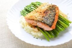 Grilled salmon garnished with asparagus stock photography