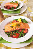 Grilled salmon with green beans and tomatoes Stock Photo