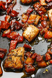 Grilled salmon in herbs on frying pan Royalty Free Stock Photography