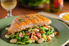 Grilled Salmon with Kale, White Beans, and Bacon Stock Image