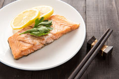 Grilled Salmon with lemon on dish Stock Image