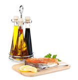 Grilled salmon with lemon and herbs on cutting board Stock Image