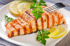 Grilled Salmon with lemon and   herbs Royalty Free Stock Photo