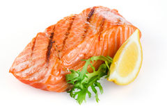 Grilled salmon with lemon isolated on white Royalty Free Stock Photo