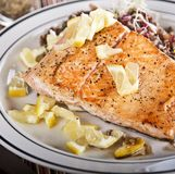 Grilled Salmon with Lemon. And salad royalty free stock photo