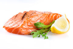 Grilled salmon with lemon on white background Stock Photography
