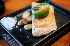 Grilled salmon with lemons stock image
