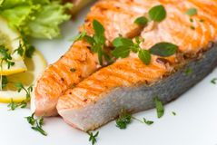 Grilled salmon with lettuce and tomato- close up Stock Photo