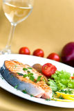 Grilled salmon with lettuce and tomato- close up Royalty Free Stock Image