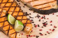 Grilled salmon with lime. Stock Image
