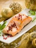 Grilled salmon over christmas table Royalty Free Stock Image