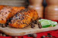 Grilled salmon. Grilled salmon with pepper and lime stock images
