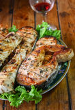 Grilled salmon. Photo image of the grilled salmon with lettuce stock photos