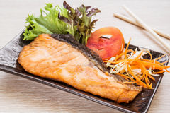 Grilled salmon on plate. Grilled salmon on a plate Royalty Free Stock Image