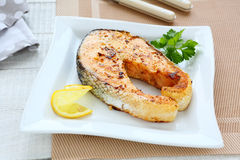 Grilled salmon on a plate. Food closeup Royalty Free Stock Photo