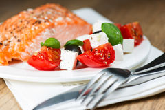 Grilled salmon on plate with greek salmon Stock Images