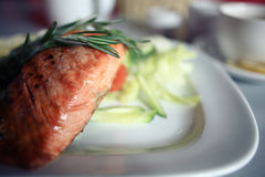 Grilled salmon on plate. In restourant Royalty Free Stock Photography