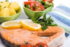 Grilled salmon with potatoes and salad Royalty Free Stock Photos