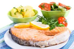Grilled salmon with potatoes and salad Stock Photography