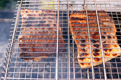 Grilled salmon ready, back side with crispy crust. Grilled salmon kebabs are ready, back side with crispy crust, cooked at nature Stock Photos