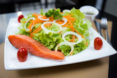 Grilled salmon salad. On white dish Stock Photography