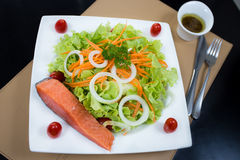 Grilled salmon salad. On white dish Stock Image