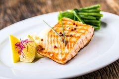 Grilled Salmon. Salmon fillet with lemon and green beans. Grilled fish Royalty Free Stock Images
