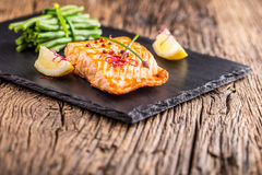 Grilled Salmon. Salmon fillet with lemon and green beans. Grilled fish Stock Photos