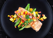 Grilled Salmon. With Salsa Salad royalty free stock photography