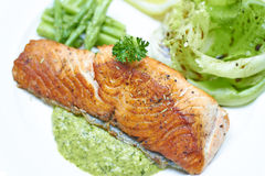 Grilled salmon with salsa verde Stock Photography