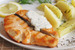Grilled salmon with sauce Royalty Free Stock Images