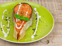 Grilled salmon. Served with creamy sauce and mint Royalty Free Stock Photography