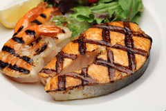 Grilled salmon with shrimps stock photography