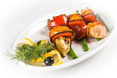 Grilled salmon skewers. On white plate Stock Images