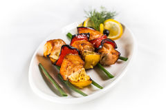 Grilled salmon skewers. On white plate Stock Photo