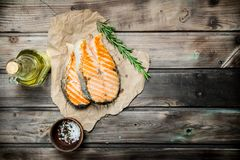 Grilled salmon with spices and rosemary stock photos